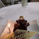 Happy Birthday chocolate cake with gold leaf