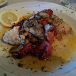 The Whaler...24 oz. Ribeye topped w/lump crab meat.  Greek Grouper onions, tomatoes & mushrooms