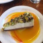 House dessert: pistachios, cheesecake, icecream and mango sauce