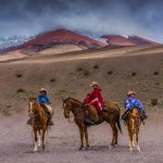 Cowboy family on vacation in the Cotopaxi Volcanic National Park outside of Quito, Ecuador