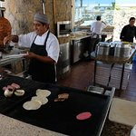 Try the sea bass tacos on freshly made tortillas at this pool side eating place