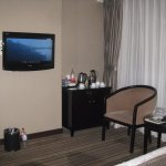 TV and sitting area with in-room tea/coffee