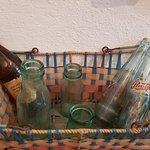 Shopping cart with milk bottles, oil bottle and Pepsi Cola bottle