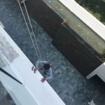 Ninja worker rappelling from roof. He was doing my balcony as I moved into the room - Lovely...