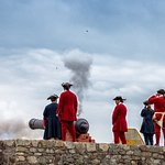 Cannon fire from the walls.