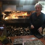 snails being cooked in the open fire oven
