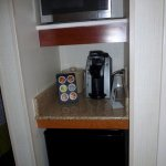 Coffee station, fridge and microwave in room