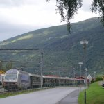 flam railway train pulling in at station across the road from hotel