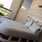 Bed outside balcony