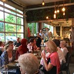 Crowded diners on a warm, humid summer evening.