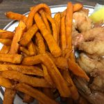 Yummy fried shrimp with sweet potato fries