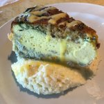 Quiche of the day on top of a bed of grits.