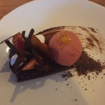 Vegan chocolate dessert with raspberry sorbet