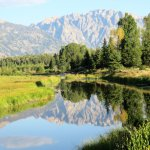 Still waters reflect the Grand Tetons