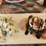 Delicious chicken salad and roasted vegetables with goat cheese on pastry puff drizzled balsamic