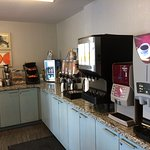 Two coffee machines, juices, yogurt, etc.