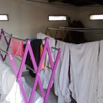 Laundry racks adjacent to the rooftop dining area