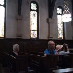 Side wall of chapel and pews during guided tour.