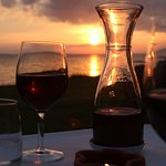Enjoying a glass of wine during a beautiful sunset over Lago Trasimeno