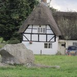 Stones in front of thatched homes