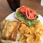 Walleye sandwich, diablo shrimp in a spicy creole sauce, service and outdoor dining by the beaut