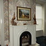 Jane Austin Room with Fireplace and Brass Peacocks on Mantle