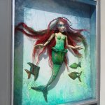 A mermaid marionette outside a puppet shop