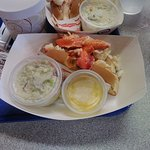 Lobster roll comes with butter, mayo, or whatever you request. It also comes with very good cold