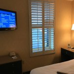 Mounted TV; Bright windows with shutters