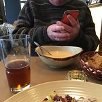 My husband enjoying his fish soup and beer