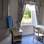 Large room with tub/shower, sink and dressing table. A separate room had the toilet