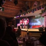 The wait staff/performers on stage
