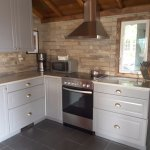New kitchen with full oven and fridge freezer