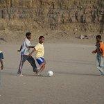 Lalibela Cross Ethiopia Eco Trekking and Tours - playing football in Lalibela