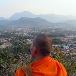 monk viewing the opposite side of the city