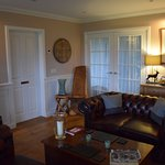The living room is accessible to guests. Enjoy a sunset with a complementary glass of scotch