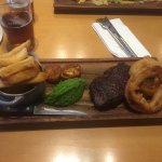10oz Sirloin, Oven Dried Tomato, Crushed Peas, Onion Rings, Chips.