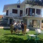 Eduardo, Valeria and our family by the house