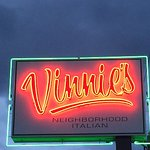 Vinnie's sign in the evening