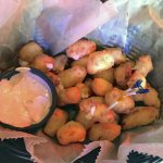 Friend white cheese curds served with gritty sauce