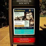 Sign on sidewalk with featured exhibition