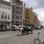 Horse and carriage traversing the square
