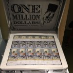 display containing $1 million in 100s
