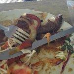 La carne de fajitas de res, duras como una suela de zapato. Si realmente es bueno, tendrían que