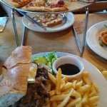 spicy chorizo pizza and french dip with fries