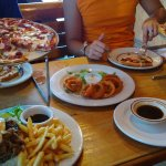 Spicy chorizo pizza, french dip w/fries, order of onion rings and combo pizza