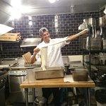 Happy little guy making the house made Buffalo mozzarella
