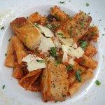 Mahi braised with marinara and fresh herbs over pasta