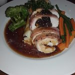 Roast chicken stuffed with black pudding and apricots
