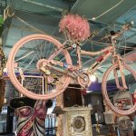 Pink bicycle, encrusted with watches in the bike frame